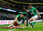 8 February 2020; Andrew Conway of Ireland celebrates with team-mate Ross Byrne, right, after scoring his side's fourth try during the Guinness Six Nations Rugby Championship match between Ireland and Wales at the Aviva Stadium in Dublin. Photo by Ramsey Cardy/Sportsfile