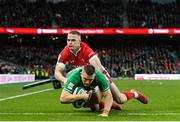 8 February 2020; Andrew Conway of Ireland dives over to score his side's fourth try despite the tackle of Johnny McNicholl of Wales during the Guinness Six Nations Rugby Championship match between Ireland and Wales at the Aviva Stadium in Dublin. Photo by Ramsey Cardy/Sportsfile