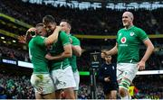 8 February 2020; Andrew Conway of Ireland celebrates with team-mates, from left, Ross Byrne, John Cooney, and Devin Toner after scoring his side's fourth try during the Guinness Six Nations Rugby Championship match between Ireland and Wales at the Aviva Stadium in Dublin. Photo by Ramsey Cardy/Sportsfile