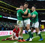 8 February 2020; Andrew Conway of Ireland celebrates with team-mate Ross Byrne, centre, and John Cooney, right. after scoring his side's fourth try during the Guinness Six Nations Rugby Championship match between Ireland and Wales at the Aviva Stadium in Dublin. Photo by Ramsey Cardy/Sportsfile