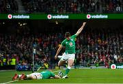 8 February 2020; Ross Byrne of Ireland kicks a conversion assisted by Andrew Conway during the Guinness Six Nations Rugby Championship match between Ireland and Wales at the Aviva Stadium in Dublin. Photo by Ramsey Cardy/Sportsfile
