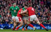 8 February 2020; Robbie Henshaw of Ireland is tackled by Dillon Lewis and Jake Ball of Wales during the Guinness Six Nations Rugby Championship match between Ireland and Wales at Aviva Stadium in Dublin. Photo by Brendan Moran/Sportsfile