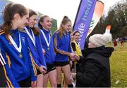 8 February 2020; President of Athletics Ireland Georgina Drumm presents a winners medal to Caoimhe Fitzsimons and her team-mates from the Ratoath AC under-14 girls relay team during the Irish Life Health National Intermediate, Master, Juvenile B & Relays Cross Country at Avondale in Rathdrum, Co Wicklow. Photo by Matt Browne/Sportsfile