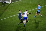 8 February 2020; Conor McManus of Monaghan shoots to score his side's first goal past Dublin goalkeeper Evan Comerford during the Allianz Football League Division 1 Round 3 match between Dublin and Monaghan at Croke Park in Dublin. Photo by Stephen McCarthy/Sportsfile