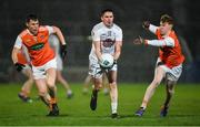 8 February 2020; David Hyland of Kildare in action against Oisín O'Neill, left, and Conor Turbitt of Armagh during the Allianz Football League Division 2 Round 3 match between Armagh and Kildare at Athletic Grounds in Armagh. Photo by Piaras Ó Mídheach/Sportsfile