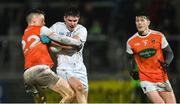 8 February 2020; David Hyland of Kildare in action against Aidan Nugent, left, and Joe McElroy of Armagh during the Allianz Football League Division 2 Round 3 match between Armagh and Kildare at Athletic Grounds in Armagh. Photo by Piaras Ó Mídheach/Sportsfile
