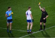 8 February 2020; Referee Ciaran Branagan issues a yellow card to Paul Mannion of Dublin and Kieran Duffy of Monaghan during the Allianz Football League Division 1 Round 3 match between Dublin and Monaghan at Croke Park in Dublin. Photo by Stephen McCarthy/Sportsfile