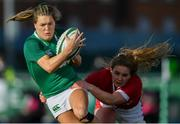 9 February 2020; Beibhinn Parsons of Ireland escapes the tackle of Manon Johnes of Wales on her way to scoring her side's first try during the Women's Six Nations Rugby Championship match between Ireland and Wales at Energia Park in Dublin. Photo by Ramsey Cardy/Sportsfile