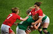 9 February 2020; Aoife McDermott of Ireland is tackled by Manon Johnes, left, and Siwan Lillicrap of Wales during the Women's Six Nations Rugby Championship match between Ireland and Wales at Energia Park in Dublin. Photo by Ramsey Cardy/Sportsfile