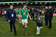 8 February 2020; Ireland captain Jonathan Sexton, accompanied by his son Luca and IRFU Communications manager David O Siochain after the Guinness Six Nations Rugby Championship match between Ireland and Wales at Aviva Stadium in Dublin. Photo by Brendan Moran/Sportsfile
