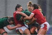 9 February 2020; Lindsay Peat of Ireland is tackled by Robyn Wilkins, left, and Alisha Butchers of Wales during the Women's Six Nations Rugby Championship match between Ireland and Wales at Energia Park in Dublin. Photo by Ramsey Cardy/Sportsfile