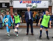 10 February 2020; The Football Association of Ireland are delighted to announce a new partnership with the leading Irish sports retailer INTERSPORT Elverys, as the new title sponsor of the FAI Summer Soccer Schools. Pictured at the announcement is Republic of Ireland manager Mick McCarthy with Larkin Community College students, from left, Adrian Lucaci, Isabelle Baker and Remis Galiceanu at INTERSPORT Elverys, Henry Street in Dublin. Photo by Stephen McCarthy/Sportsfile