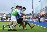 11 February 2020; Dylan Ryan of St Michaels College is tackled by Brian Barron and Hugh Lynn of Gonzaga College during the Bank of Ireland Leinster Schools Senior Cup Second Round match between Gonzaga College and St Michaels College at Energia Park in Dublin. Photo by Ramsey Cardy/Sportsfile