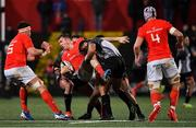 14 February 2020; Chris Farrell of Munster is tackled by Erich Cronje of Isuzu Southern Kings during the Guinness PRO14 Round 11 match between Munster and Isuzu Southern Kings at Irish Independent Park in Cork. Photo by Brendan Moran/Sportsfile