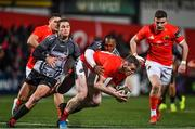 14 February 2020; Chris Farrell of Munster is tackled by Andell Loubser of Isuzu Southern Kings during the Guinness PRO14 Round 11 match between Munster and Isuzu Southern Kings at Irish Independent Park in Cork. Photo by Brendan Moran/Sportsfile