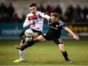 14 February 2020; Conor McCormack of Derry City and Jordan Flores of Dundalk during the SSE Airtricity League Premier Division match between Dundalk and Derry City at Oriel Park in Dundalk, Louth. Photo by Stephen McCarthy/Sportsfile