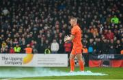 15 February 2020; Bohemians goalkeeper James Talbot walks past a flare that was thrown onto the pitch ahead of the SSE Airtricity League Premier Division match between Bohemians and Shamrock Rovers at Dalymount Park in Dublin. Photo by Seb Daly/Sportsfile