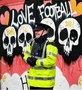 15 February 2020; A member of An Garda Síochána watches on ahead of the SSE Airtricity League Premier Division match between Bohemians and Shamrock Rovers at Dalymount Park in Dublin. Photo by Stephen McCarthy/Sportsfile