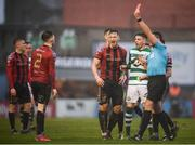 15 February 2020; Referee Rob Hennessy issues a red card to Andy Lyons, 2, of Bohemians during the SSE Airtricity League Premier Division match between Bohemians and Shamrock Rovers at Dalymount Park in Dublin. Photo by Stephen McCarthy/Sportsfile