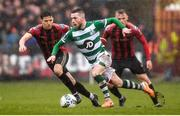 15 February 2020; Jack Byrne of Shamrock Rovers in action against Keith Buckley, left, and JJ Lunney of Bohemians during the SSE Airtricity League Premier Division match between Bohemians and Shamrock Rovers at Dalymount Park in Dublin. Photo by Stephen McCarthy/Sportsfile