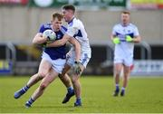 16 February 2020; Bryan Magee of Cavan in action against Seán Byrne of Laois during the Allianz Football League Division 2 Round 3 match between Laois and Cavan at MW Hire O'Moore Park in Portlaoise, Laois. Photo by Piaras Ó Mídheach/Sportsfile