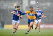 16 February 2020; David Reidy of Clare in action against James Keyes of Laois during the Allianz Hurling League Division 1 Group B Round 3 match between Clare and Laois at Cusack Park in Ennis, Clare. Photo by Eóin Noonan/Sportsfile