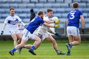 16 February 2020; Gary Walsh of Laois in action against Chris Conroy, left, and Padraig Faulkner of Cavan during the Allianz Football League Division 2 Round 3 match between Laois and Cavan at MW Hire O'Moore Park in Portlaoise, Laois. Photo by Piaras Ó Mídheach/Sportsfile