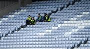16 February 2020; Stewards shelter from the bad weather in the main stand during the Allianz Football League Division 2 Round 3 match between Laois and Cavan at MW Hire O'Moore Park in Portlaoise, Laois. Photo by Piaras Ó Mídheach/Sportsfile