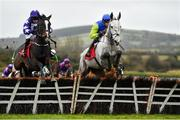19 February 2020; Mary Frances, with Cathal Landers up, jump a fence ahead of Flawless Escape, with Denis O'Regan up, on their way to winning the Pertemps Network Group Handicap Hurdle at Punchestown Racecourse in Kildare. Photo by Harry Murphy/Sportsfile