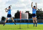 """20 February 2020; Dublin camogie player Laura Twomey, left, and Dublin footballer Leah Caffrey were in Parnell Park today launching the AIG """"Show Your Skills' Challenge in support of 20x20. AIG are calling on women and girls of all ages, all abilities and all sports to showcase their talents by entering the online competition at aig.ie/skills to be in with a chance to win a monthly €1,000 prize. Photo by Seb Daly/Sportsfile"""