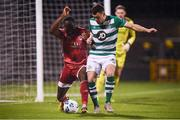 21 February 2020; Joseph Olowu of Cork City in action against Aaron Greene of Shamrock Rovers during the SSE Airtricity League Premier Division match between Shamrock Rovers and Cork City at Tallaght Stadium in Dublin. Photo by Stephen McCarthy/Sportsfile