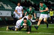 21 February 2020; Hayden Hyde of Ireland scores his side's second try despite the tackle of Connor Doherty of England during the Six Nations U20 Rugby Championship match between England and Ireland at Franklin's Gardens in Northampton, England. Photo by Brendan Moran/Sportsfile