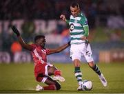 21 February 2020; Graham Burke of Shamrock Rovers in action against Henry Ochieng of Cork City during the SSE Airtricity League Premier Division match between Shamrock Rovers and Cork City at Tallaght Stadium in Dublin. Photo by Stephen McCarthy/Sportsfile