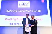 21 February 2020; Eoin Delaney from Crettyard, Co. Laois, is presented with the Young Volunteer of the Year award by Ladies Gaelic Football Association President Marie Hickey at the 2019 LGFA Volunteer of the Year awards night at Croke Park in Dublin. Photo by Piaras Ó Mídheach/Sportsfile