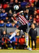 21 February 2020; Ciaran Coll of Derry City in action against David Webster of Finn Harps during the SSE Airtricity League Premier Division match between Derry City and Finn Harps at Ryan McBride Brandywell Stadium in Derry. Photo by Oliver McVeigh/Sportsfile