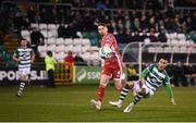 21 February 2020; Graham Burke of Shamrock Rovers shoots to score his side's sixth goal, despite the attempts of Rob Slevin of Cork City, during the SSE Airtricity League Premier Division match between Shamrock Rovers and Cork City at Tallaght Stadium in Dublin. Photo by Stephen McCarthy/Sportsfile