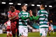 21 February 2020; Graham Burke is congratulated by his Shamrock Rovers team-mate Dylan Watts, left, after scoring their fifth goal during the SSE Airtricity League Premier Division match between Shamrock Rovers and Cork City at Tallaght Stadium in Dublin. Photo by Stephen McCarthy/Sportsfile