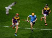22 February 2020; Cian O'Callaghan of Dublin in action against Paul Morris and Michael Dwyer of Wexford as a seagull flies during the Allianz Hurling League Division 1 Group B Round 4 match between Dublin and Wexford at Croke Park in Dublin. Photo by Harry Murphy/Sportsfile