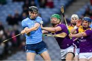 22 February 2020; Ronan Hayes of Dublin gets a shot away under pressure from Matthew O'Hanlon, centre, and Kevin Foley of Wexford during the Allianz Hurling League Division 1 Group B Round 4 match between Dublin and Wexford at Croke Park in Dublin. Photo by Sam Barnes/Sportsfile