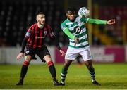 22 February 2020; Thomas Oluwa of Shamrock Rovers II in action against Shane Elworthy of Longford Town during the SSE Airtricity League First Division match between Longford Town and Shamrock Rovers II at Bishopsgate in Longford. Photo by Stephen McCarthy/Sportsfile
