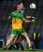 22 February 2020; Paul Mannion of Dublin scores his side's first goal despite the attention of Neil McGee of Donegal during the Allianz Football League Division 1 Round 4 match between Dublin and Donegal at Croke Park in Dublin. Photo by Sam Barnes/Sportsfile