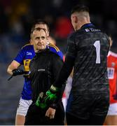 22 February 2020; Referee Brendan Cawley with Tipperary goalkeeper Evan Comerford after the Allianz Football League Division 3 Round 4 match between Tipperary and Cork at Semple Stadium in Thurles, Tipperary. Photo by Piaras Ó Mídheach/Sportsfile