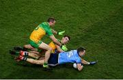 22 February 2020; Dean Rock of Dublin is tackled by Odhrán McFadden Ferry and Neil McGee of Donegal during the Allianz Football League Division 1 Round 4 match between Dublin and Donegal at Croke Park in Dublin. Photo by Harry Murphy/Sportsfile