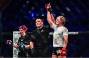 22 February 2020; Leah McCourt is declared victorious following her women's featherweight bout with Judith Ruis at Bellator Dublin in the 3 Arena, Dublin. Photo by David Fitzgerald/Sportsfile