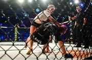 22 February 2020; Leah McCourt, top, and Judith Ruis during their women's featherweight bout at Bellator Dublin in the 3 Arena, Dublin. Photo by David Fitzgerald/Sportsfile