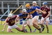 23 February 2020; Derek McNicholas of Westmeath in action against Séamus Kennedy and Ronan Maher of Tipperary during the Allianz Hurling League Division 1 Group A Round 4 match between Tipperary and Westmeath at Semple Stadium in Thurles, Co Tipperary.  Photo by Michael P Ryan / Sportsfile