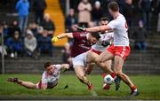 23 February 2020; Damien Comer of Galway is tackled by Liam Rafferty, left, and Ronan McNamee of Tyrone resulting in a penalty during the Allianz Football League Division 1 Round 4 match between Galway and Tyrone at Tuam Stadium in Tuam, Galway.  Photo by David Fitzgerald/Sportsfile