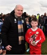 23 February 2020; Cathal O'Sullivan of Cork SL is presented with he player of the match award by FAI President Gerry McAnaney following the U13 SFAI Subway Liam Miller Cup National Championship Final match between Cork SL and DDSL at Mullingar Athletic FC in Gainestown, Co. Westmeath. Photo by Eóin Noonan/Sportsfile