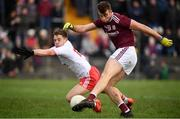 23 February 2020; Paul Conroy of Galway shoots to score his side's second goal despite the attempted challenge from Mark Bradley of Tyrone during the Allianz Football League Division 1 Round 4 match between Galway and Tyrone at Tuam Stadium in Tuam, Galway.  Photo by David Fitzgerald/Sportsfile