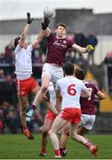 23 February 2020; Tom Flynn of Galway in action against Colm Cavanagh of Tyrone during the Allianz Football League Division 1 Round 4 match between Galway and Tyrone at Tuam Stadium in Tuam, Galway.  Photo by David Fitzgerald/Sportsfile